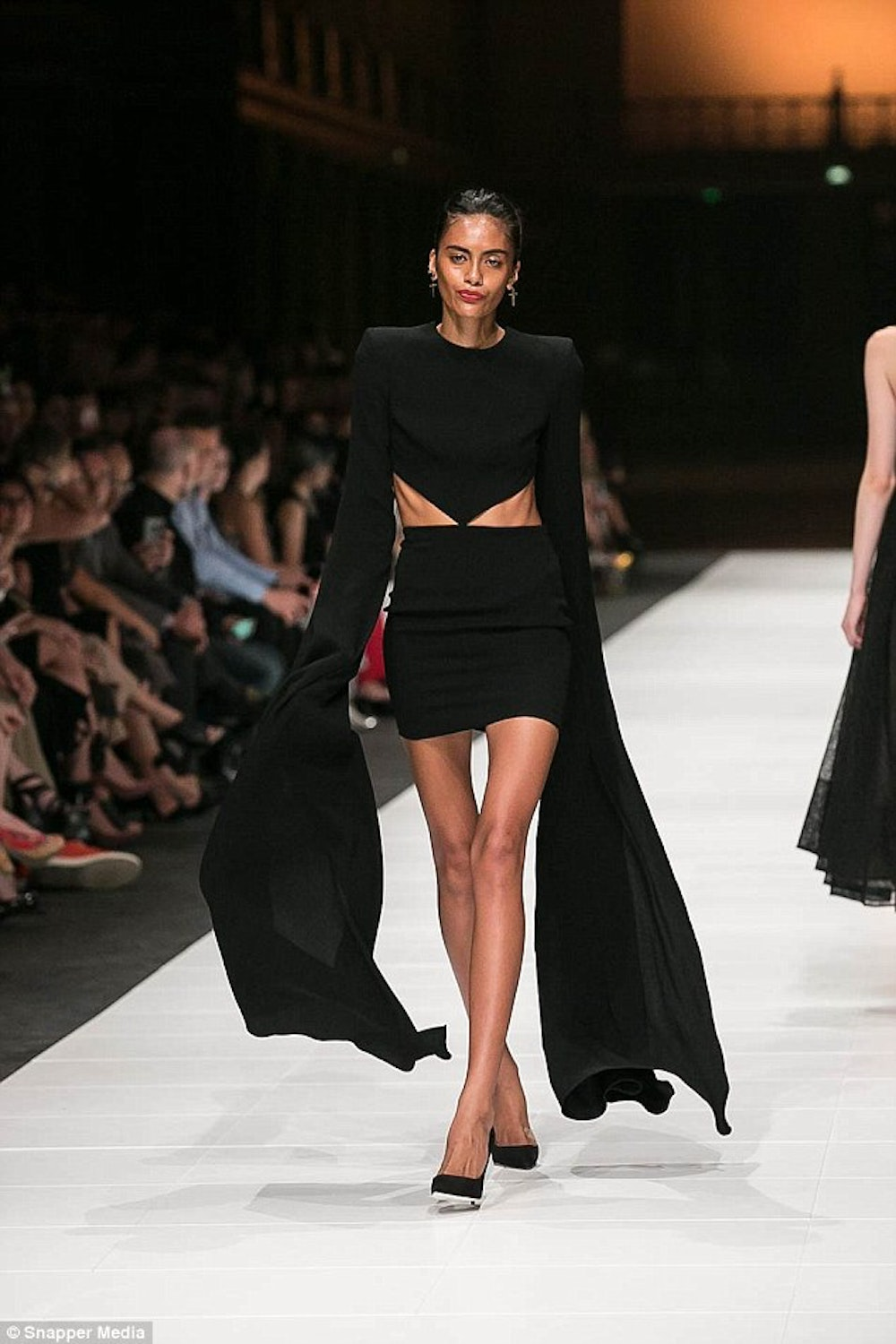 Skeletal Model Holly Moore Walks The Runway In Melbourne In A Black Dress  With Ribs Showing